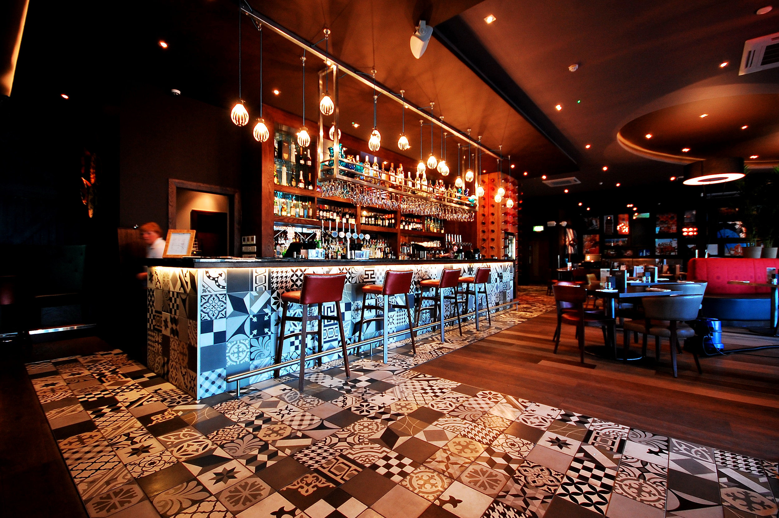 Si Bar, near Glasgow - Black and White encaustic tiles in entrance and on bar front of this bar in Scotland.