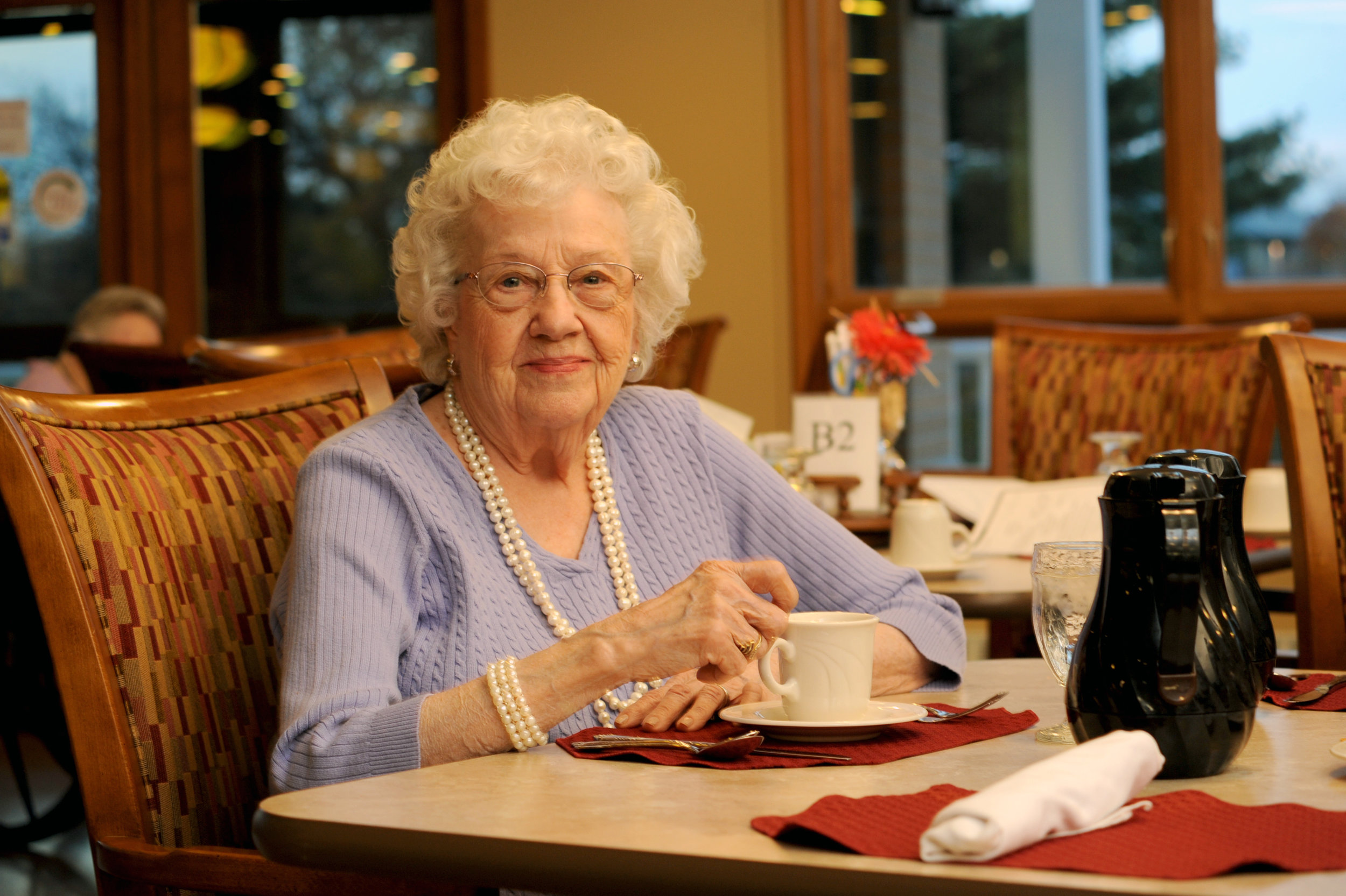 """""""The staff is so friendly and helpful, from the CEO to the great high school students who work as servers in the dining room. Everyone is here for us, all of the time. In a nutshell, I'd say that we're family and they treat us like family."""" - MARY ANN SMITH, PINES VILLAGE RESIDENT"""