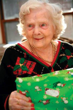 Elder-Woman-with-Present.jpg