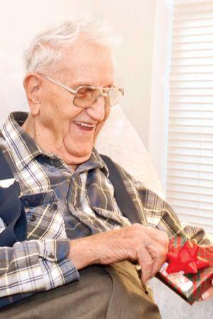 elderly-man-opens-gift.jpg