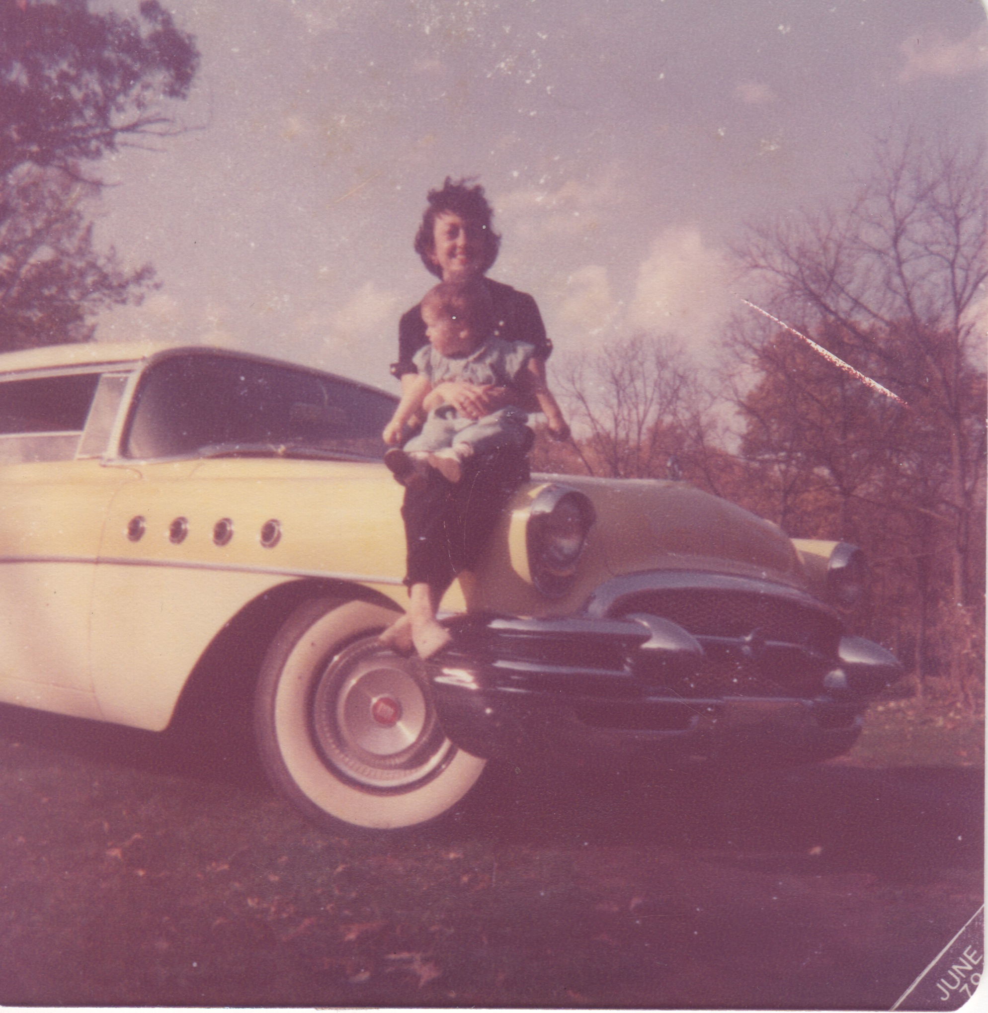 Me Mom and the yellow buick.jpeg
