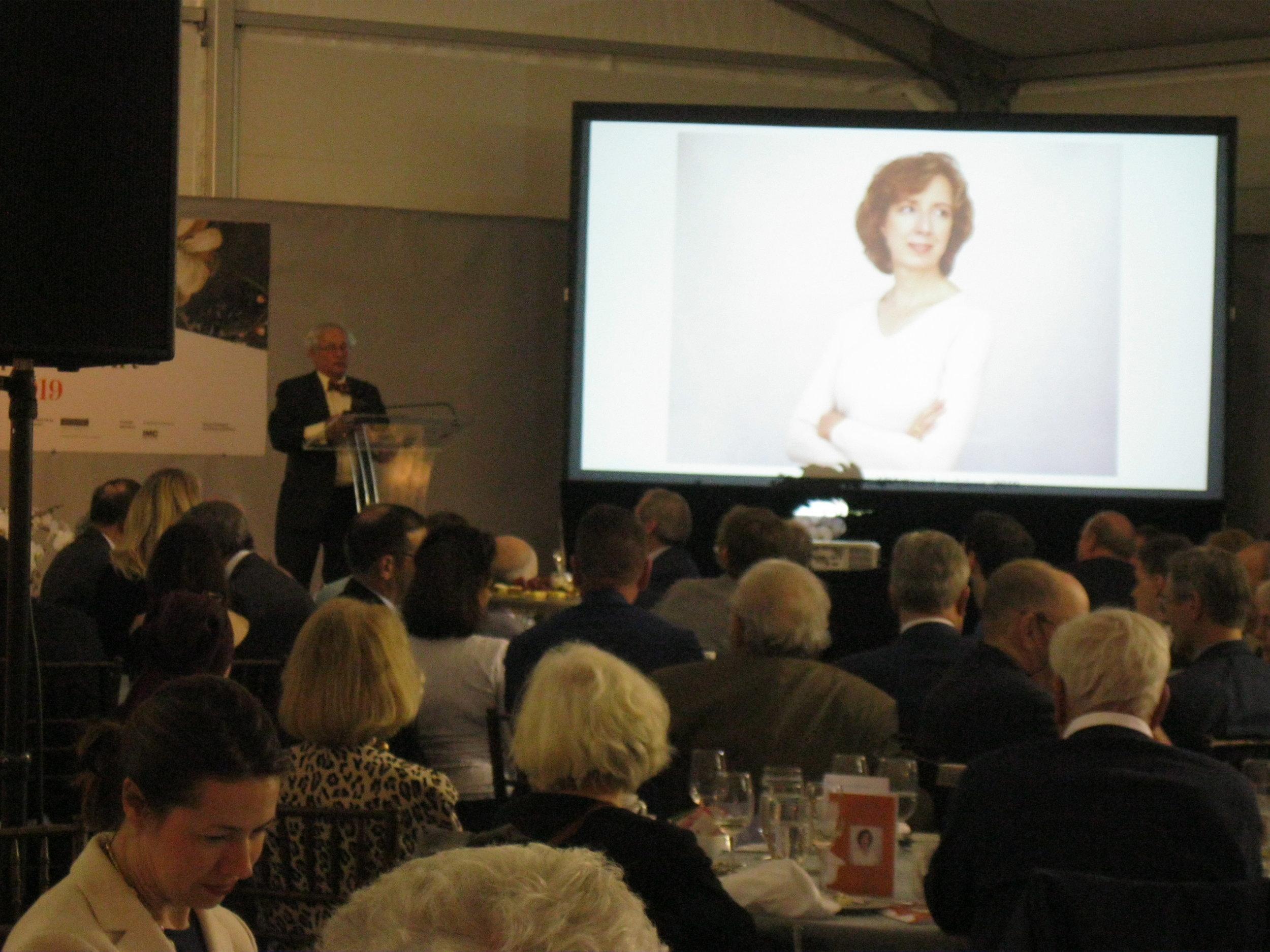 Arthur Liverant announcing 2019 Award of Merit recipient, Laura Beach.