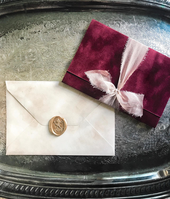 burgundy-wedding-velvet-wrap-around-wedding-invitation-silk-ribbon-elegant-romantic-beautiful-custom-wax-seal-old-world-european-inspired-vintage-wedding-invitations-save-the-dates-traditional-handwritten-calligraphy-by-leslie-and-paper-services-in-nj.jpg