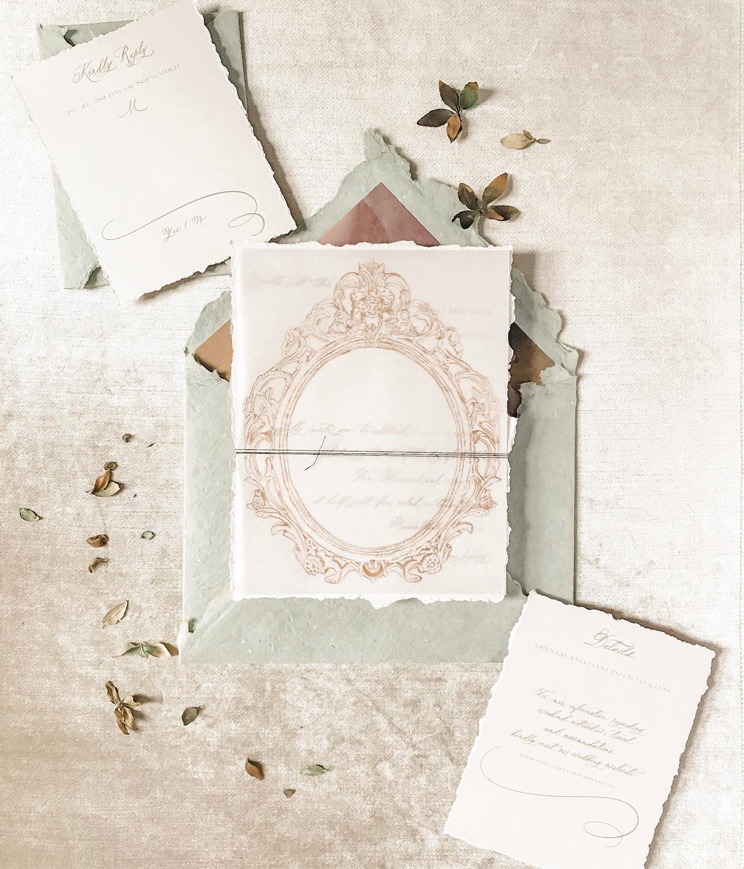 vintage-inspired-victorian-french-ornate-old-world-vellum-overlap-handmade-paper-custom-wedding-invitations-in-new-jersey-nj-by-leslie-and-paper-handwritten-full-calligraphy-custom-monogram-crest-digital-printing-letterpress.jpg