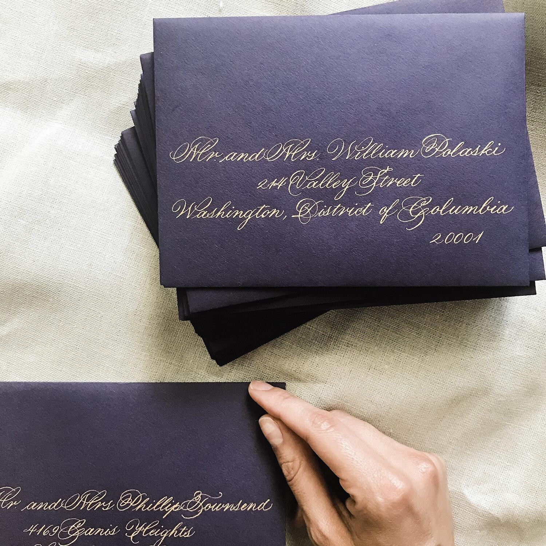 handwritten-calligraphy-services-in-nj-new-jersey-by-leslie-and-paper-romantic-elegant-gold-calligraphy-dark-purple-envelope-custom-wedding-invites.jpg