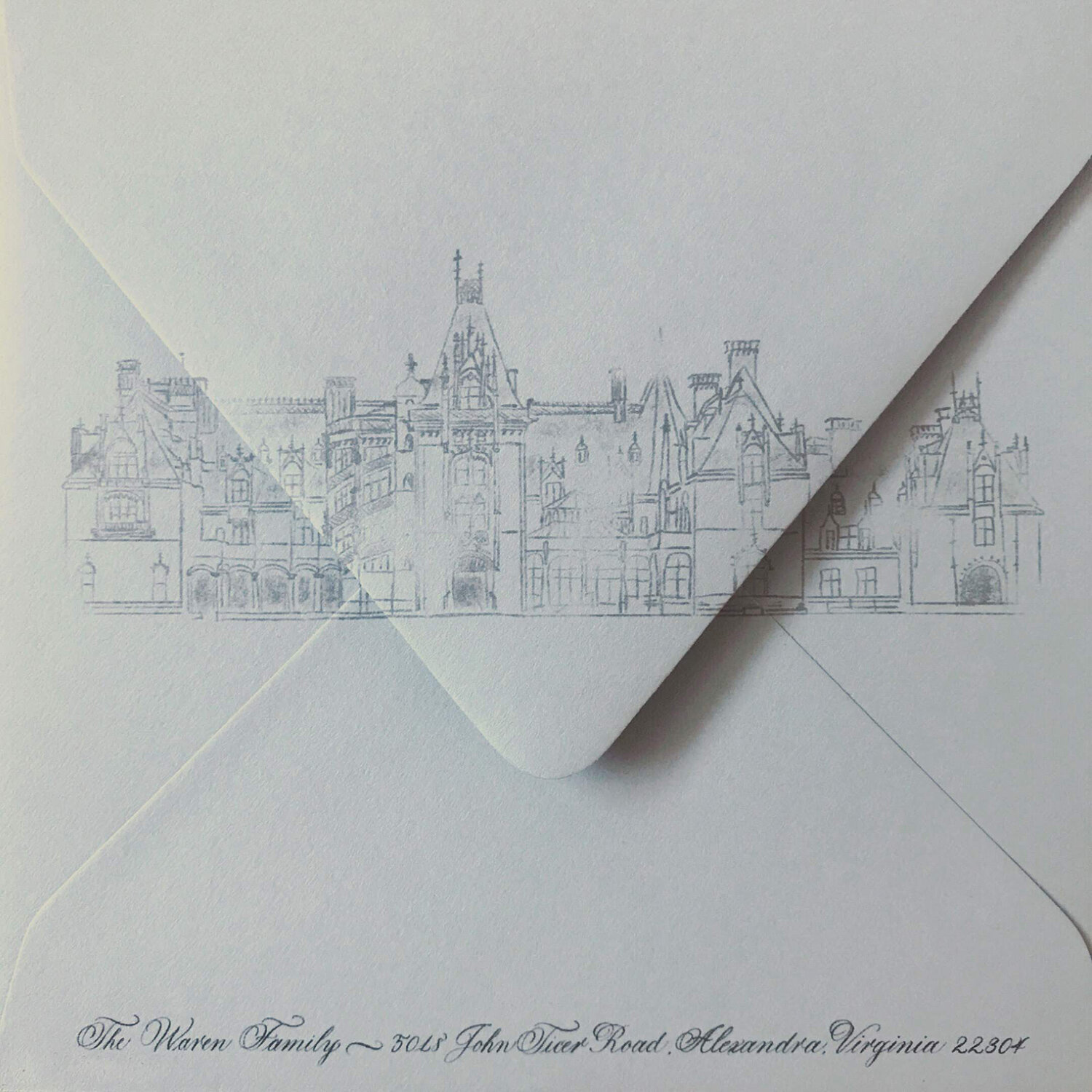 custom-wedding-venue-illustration-on-dusty-blue-envelope-handwritten-calligraphy-guest-address-by-leslie-and-paper-located-in-nj-new-jersey.jpg