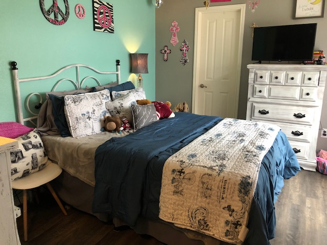 AFTER - Fourteen bags of donations later, Brennan got her wish! This cozy, clean bedroom turned out beautifully and she was SO proud to show her parents what she did.