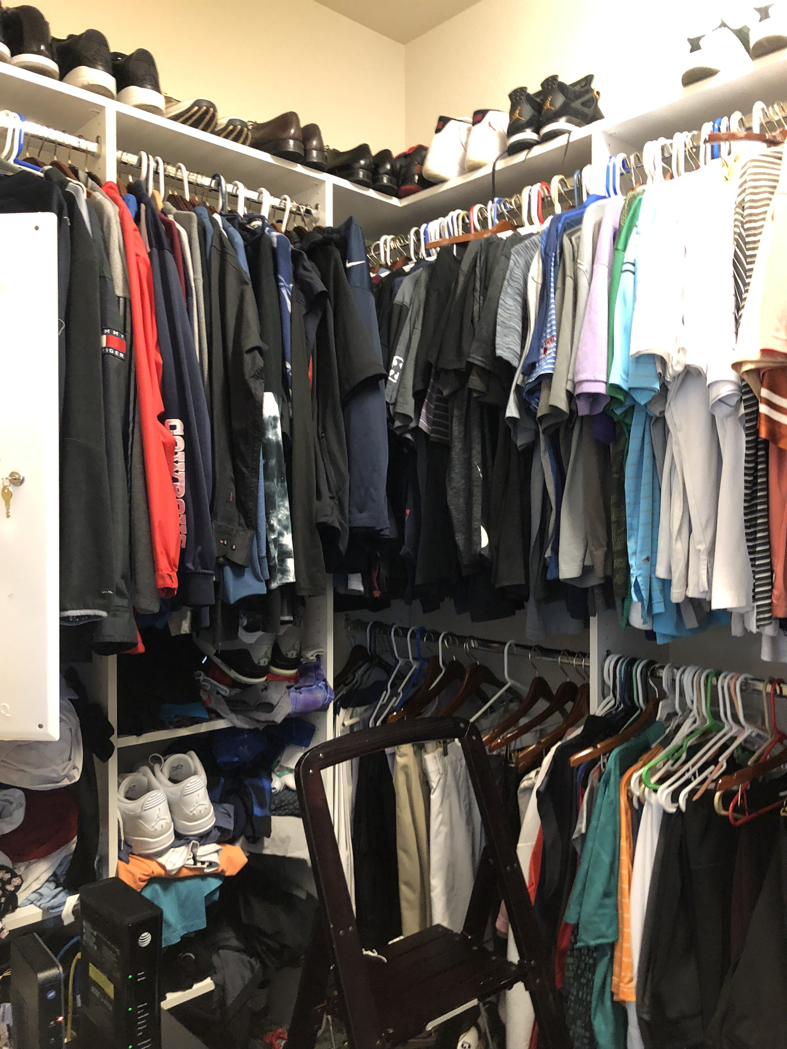 "BEFORE - This self-described ""sneaker head"" loves all things sports and fashion but this closet was not working for him."