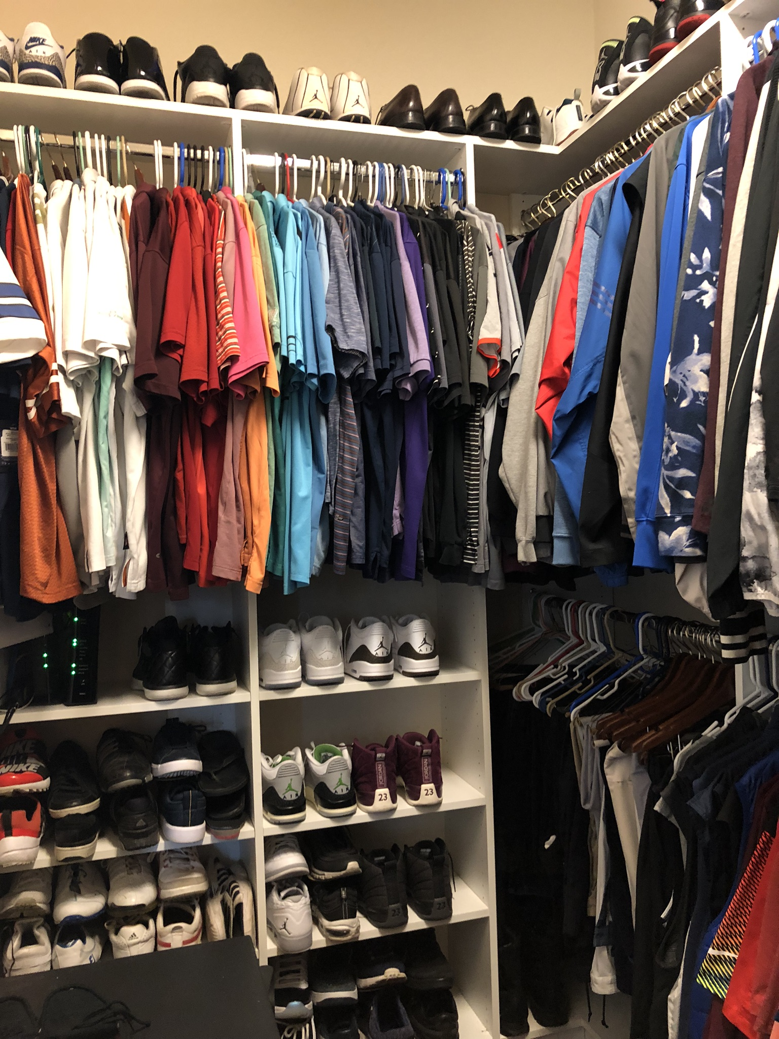 AFTER - With a little bit of purging and a lot of rearranging, this closet is now fun and functional - and a great place to show off his sneaker collection!