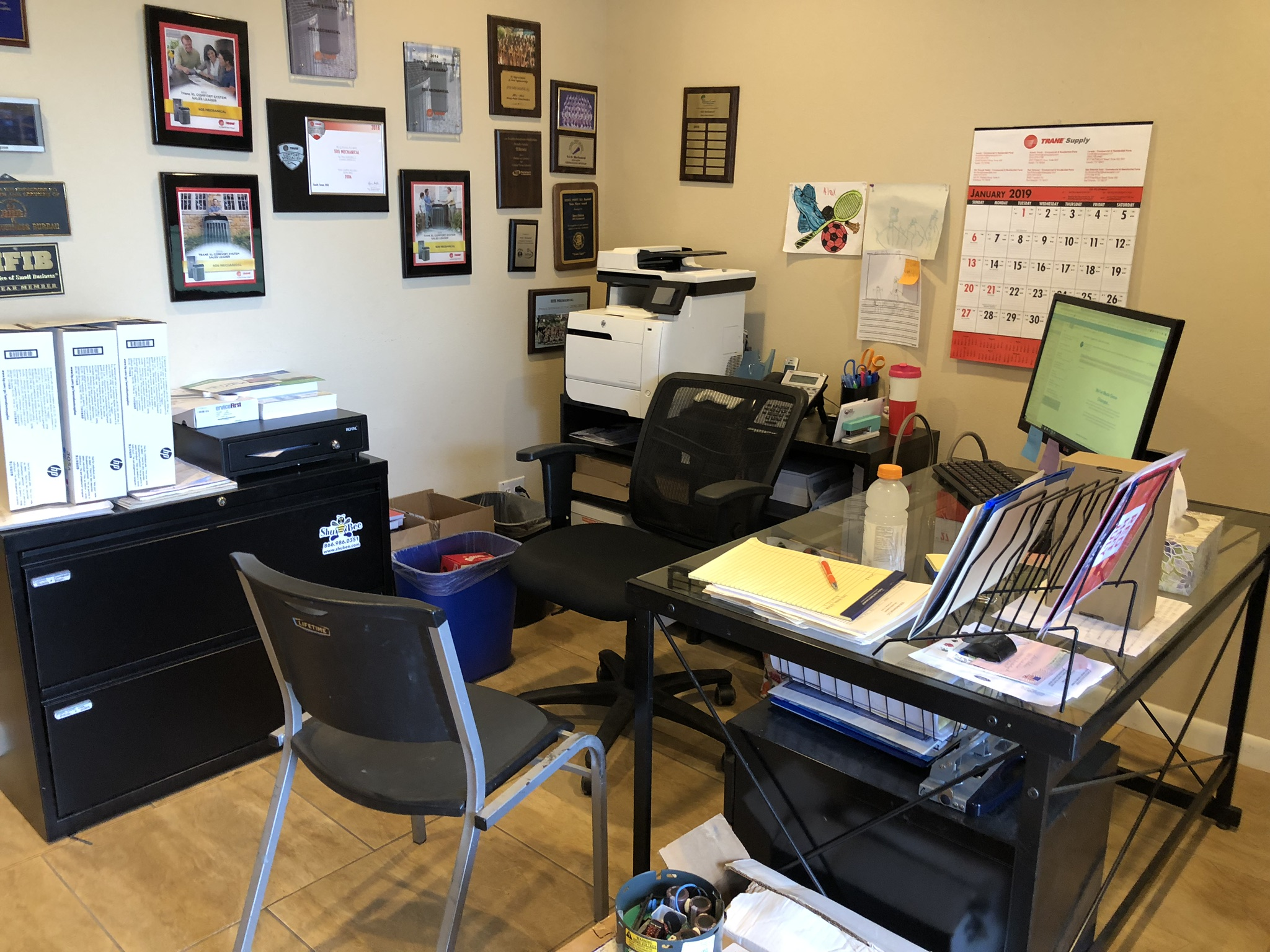 BEFORE - This Office Manager was gifted a session with us by her supervisor. (Talk about work perks!) She was already doing a great job of keeping like things together but this work space needed a serious purge.
