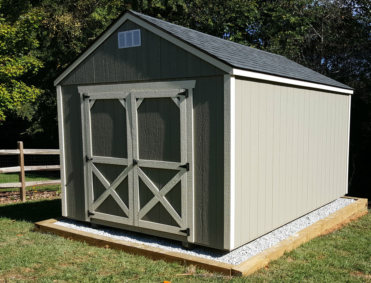 w-painted-utility-shed-on-gravel-pad.jpg