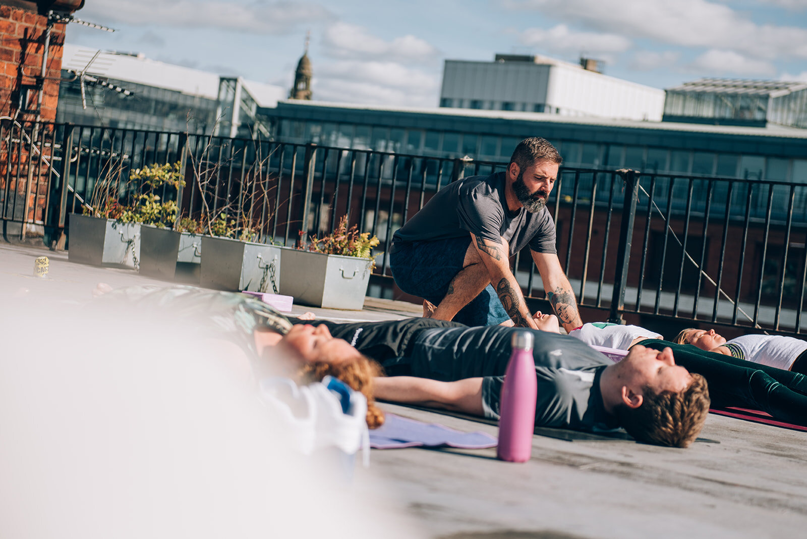 Founder Borja at our Let's get it Om! Festival rooftop stretch.