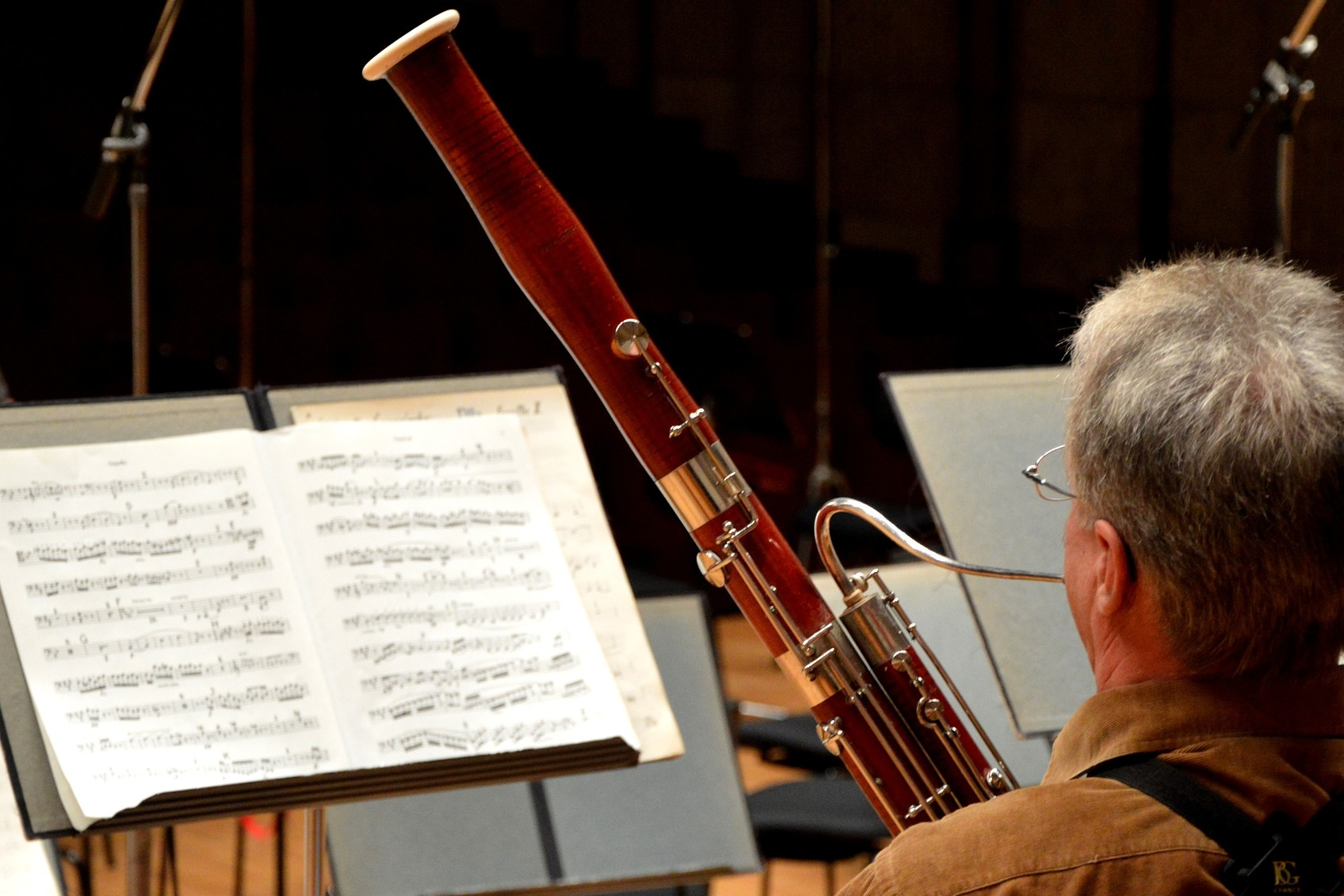 """Bassoon & Contrabassoon - Bassoon's also got a double reed (a bigger one), but the body of the instrument is MUCH larger. Bassoon is played off to the side like a saxophone, and looks like a brown or reddish big long stick with a hole up at the top that the player plays into the middle of. The CONTRABASSOON is just a bigger version, with more wooden """"piping"""" wrapped around, and it sounds super frickin' low. The bassoon sounds vibrate-y – a bit like a duck, or an electronic sound, but in a really good way."""