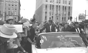 During the 1960s, many prominent politicians visited Evansville. This included then Senator John F. Kennedy on October 5, 1960. Kennedy spoke from the steps of the (Old) Courthouse, and his motorcade traversed a route including the downtown, west, and north sides.   Collection of the University of Southern Indiana Archives