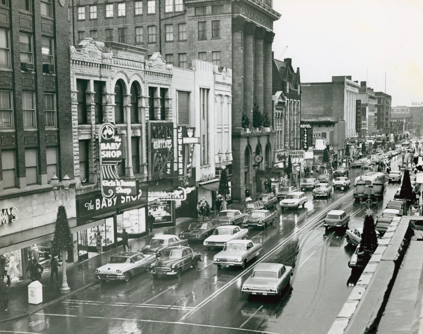 This photograph depicts Main Street during the Christmas shopping season of 1962. Taken at Fourth Street, it looks toward Fifth and Sixth Streets. In the ensuing years, and hastened by the opening of Washington Square Mall in 1963, retail shopping exited downtown.   Collection of the Evansville Museum