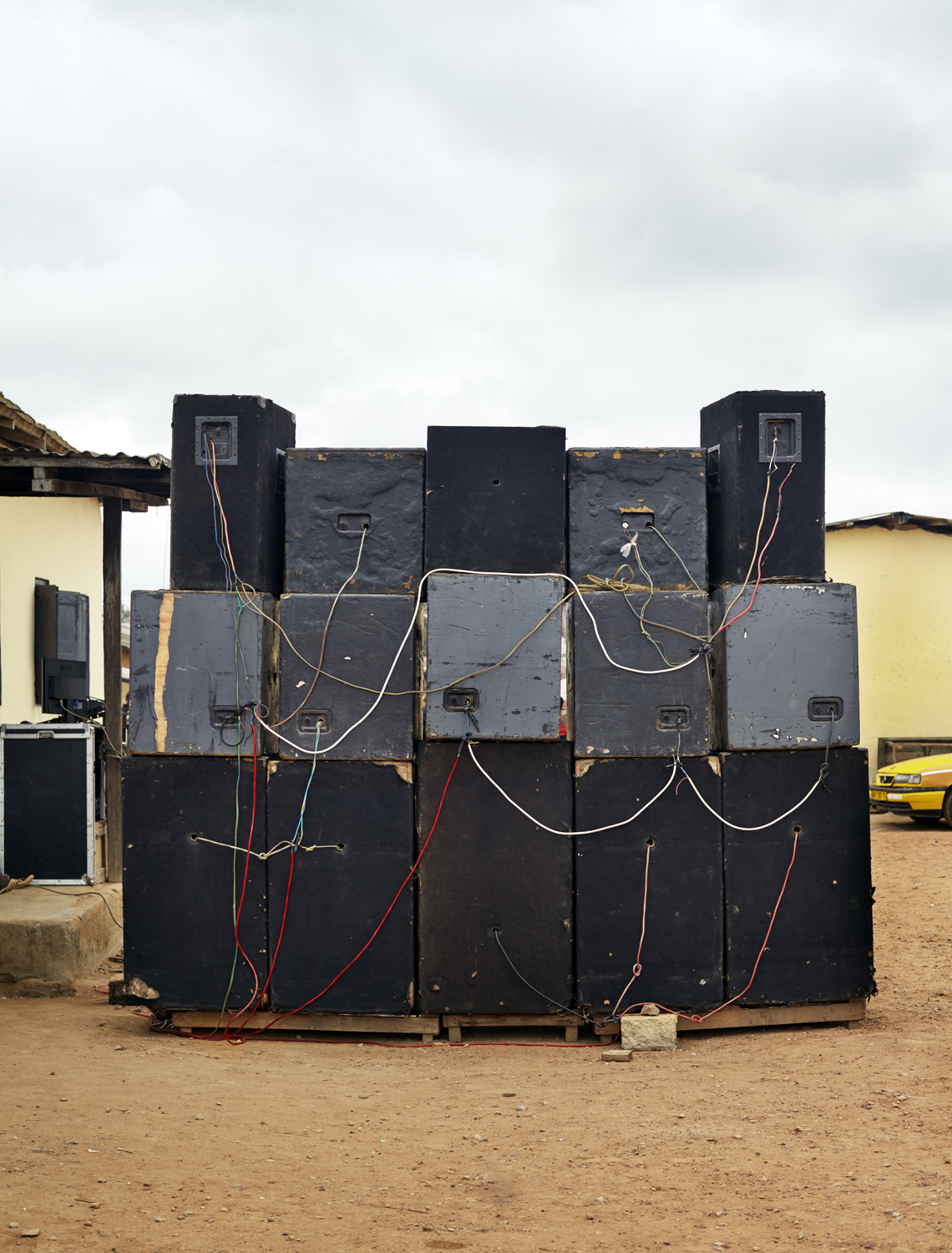 Funeral Sound System , Ghana 2014  Archival Pigment Print 16 x 20, Edition of 7 (1-3 available) $1500  Funerals are big celebrations in Ghana, typically costing as much, or more, than weddings. Colorful funeral announcements are plastered throughout towns. Friends and relatives, decked in black and red, arrive from miles around to dance and celebrate the life of the deceased.