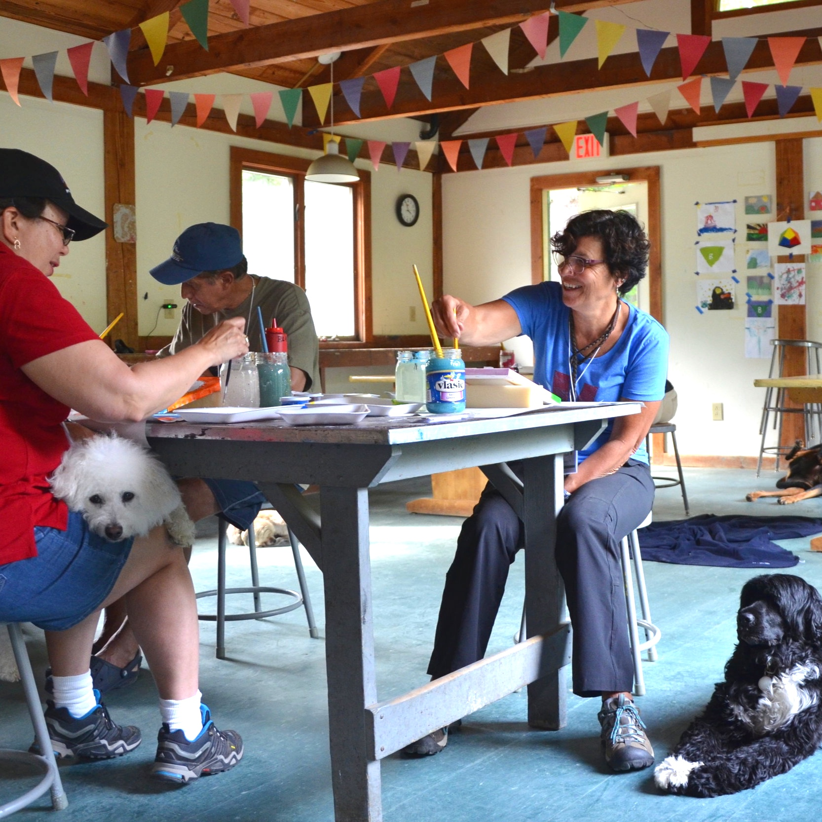 Arts & Crafts - You can make a fun tug toy, decorate a frame for your dog's photo, create a dog brag book, or paint your pup! We're always adding new dog-related projects. Relax, enjoy some music, and sip a little wine while you chat and create with your dog resting at your feet.