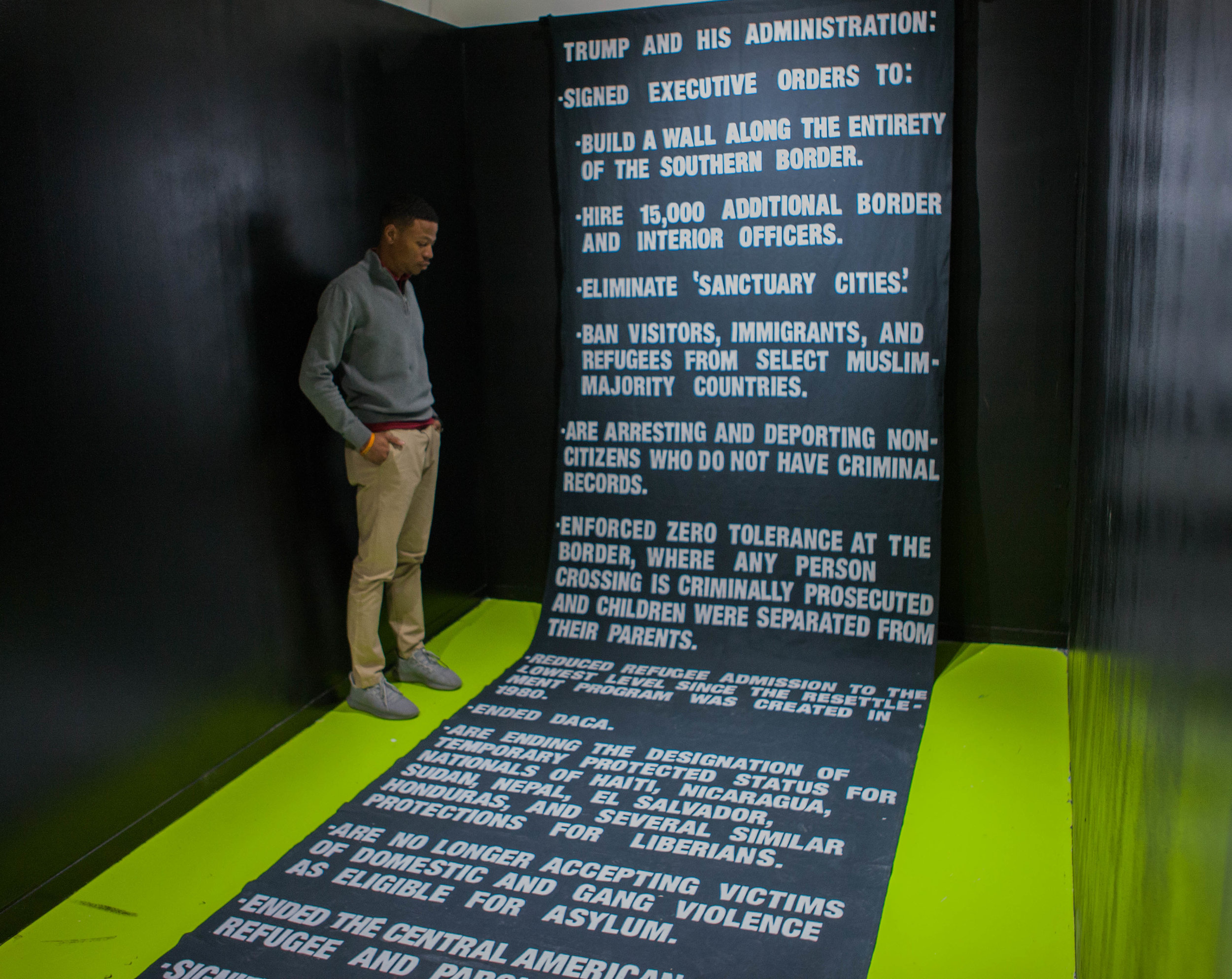 Robert looks down at a commemorative installation at a museum.