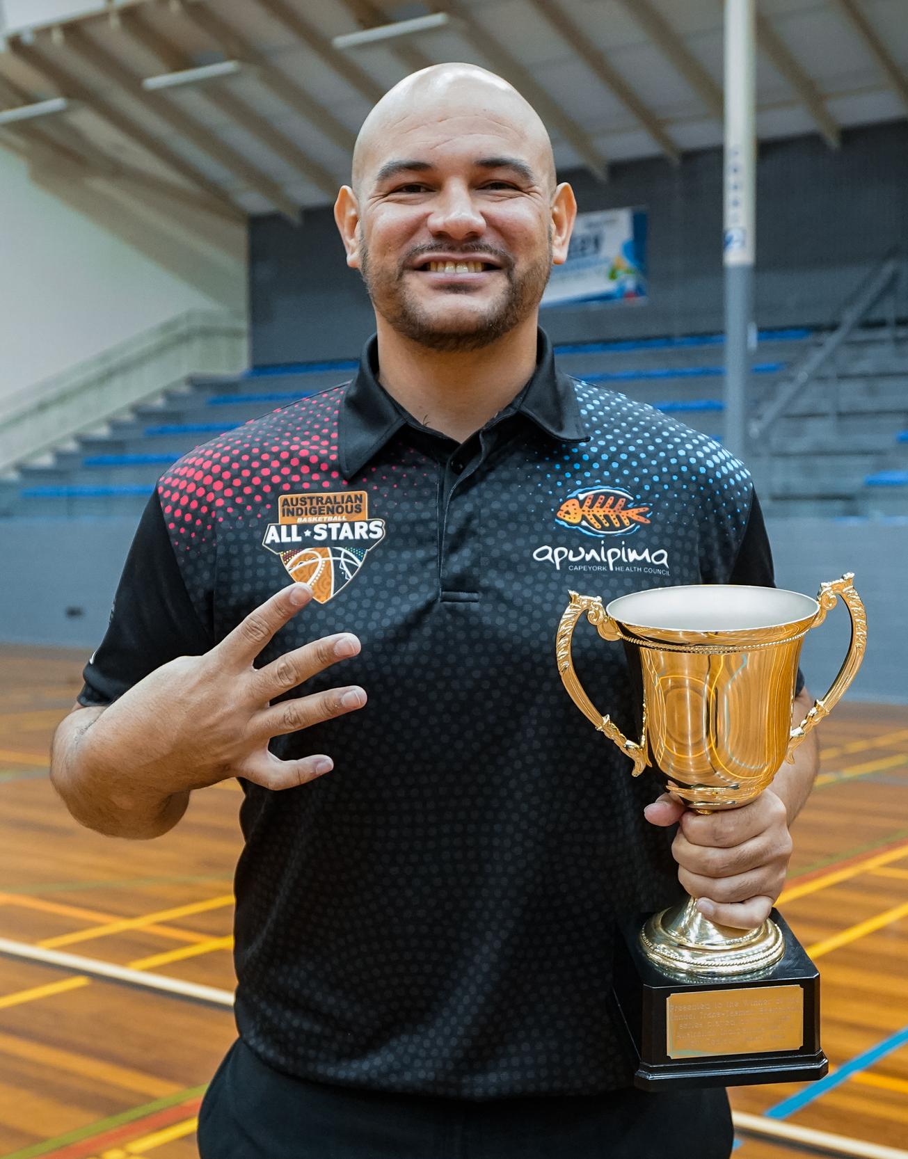 Khalu holding the Trans-Tasman Trophy. Picture: Adekponya