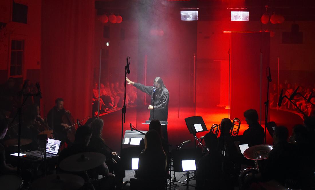 Aaron Wyatt conducting the Australian Bass Orchestra. Image by Toni Wilkinson