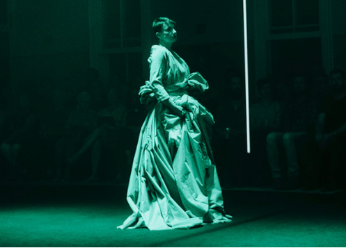 The green opera gown on stage, as worn by Judith Dodsworth. The sleeve  the soloist wears is stitched into the larger piece. One of the light  bars is also clearly visible here.