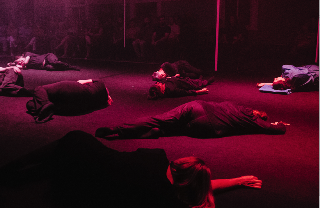 Some of the bodies on the floor in the feedback interlude between Act II and Act III. Photo by Rachel Barrett.