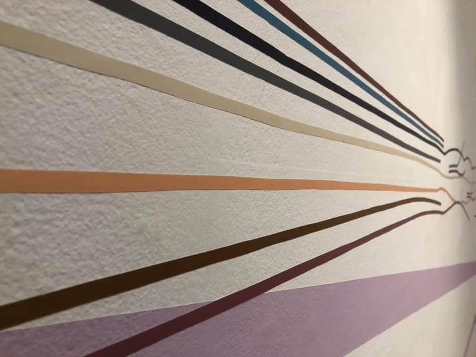 Detail of one wall of the installation. This sequence is taken from the door frame patterns.