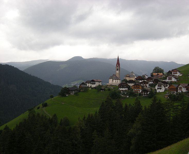 Lower down on the slopes are tiny villages surrounded by meadows and forests.