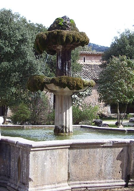 The fountain in the court of Monastery Lluc, where the lime-rich water has caused a mountain of sinter to grow on the top.