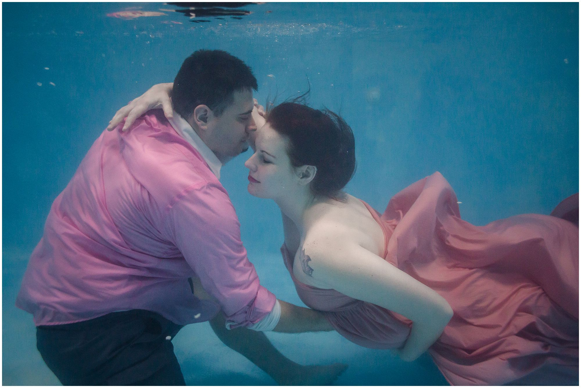 Couple photographed underwater for Colorado maternity session