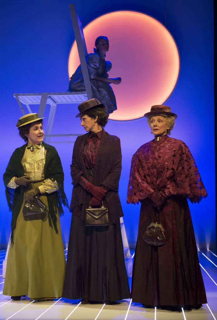 (foreground, l to r) Jenny L. Wright as Mrs. Webb, Catherine McGregor as Mrs. Gibbs, Sharry Flett as Mrs. Soames and Kate Besworth as Emily Webb (background) in Our Town. Photo by David Cooper.