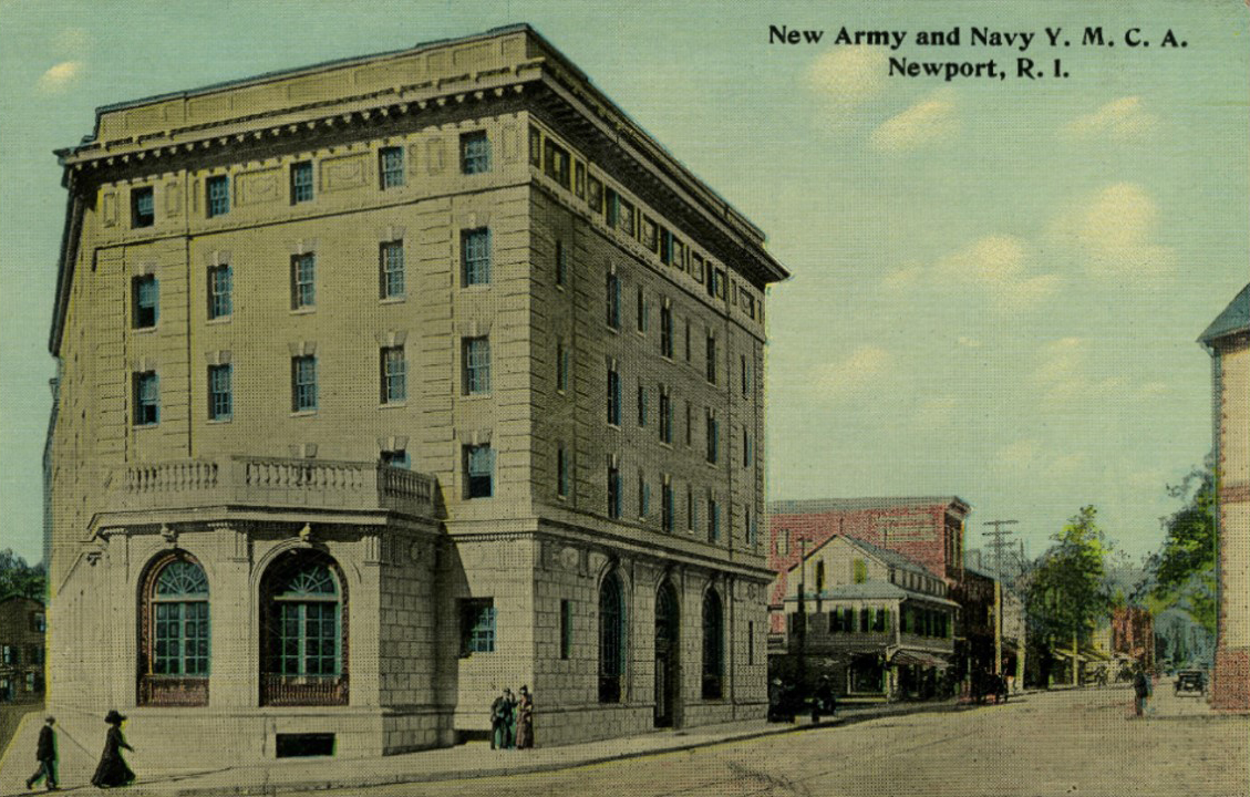 """North up Broadway. Mino  """"At the bottom of Broadway, at a corner of Washington Square, and across the street from the Old Colony House, there stood a store I visited daily. It sold newspapers, magazines, picture postcards, maps for tourists, toys for children, and even Butterick Patterns.  You can see the Materas store directly beyond the Army & Navy YMCA. The Materas were Italians who lived above the store. This was a store until the 1980's."""