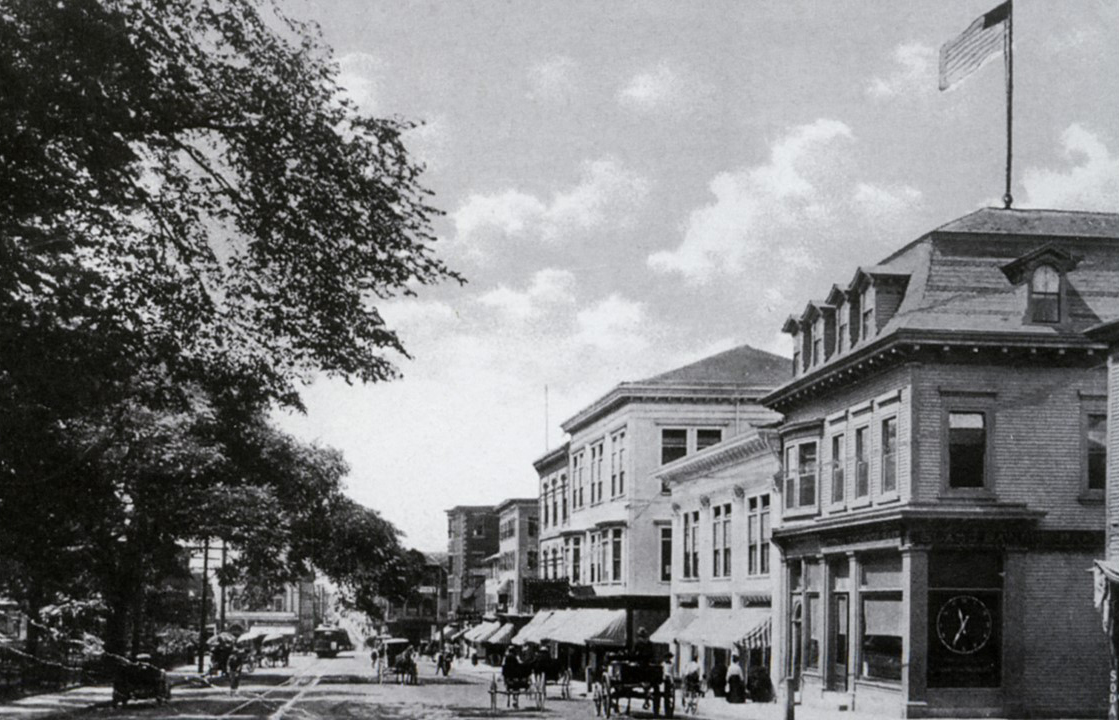 Another view looking west down Washington Square (c. early 1900). The buildings have changed and the street car is now seen in the picture.
