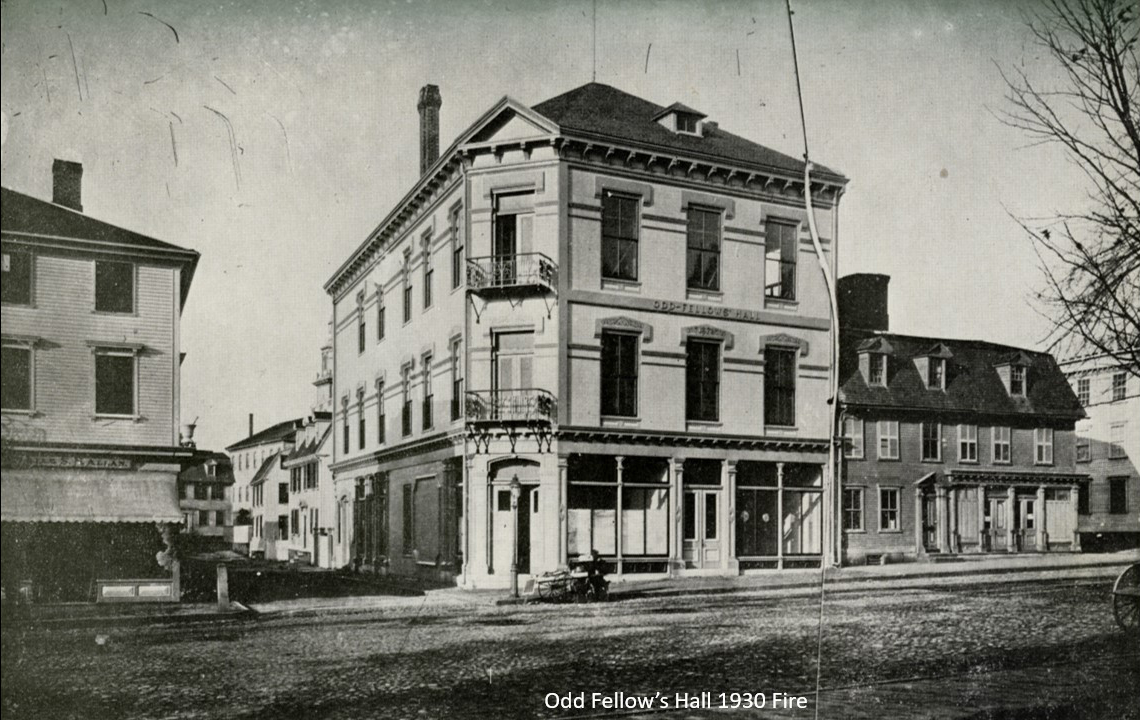 This view on Washington Square, looking north shows the old Odd Fellow's Hall which stood until 1930. To the left on the other side of Charles Street, is a 3-story store which, in 1925, would be torn down to make way for a bank. Theophilus would have seen this building being constructed.