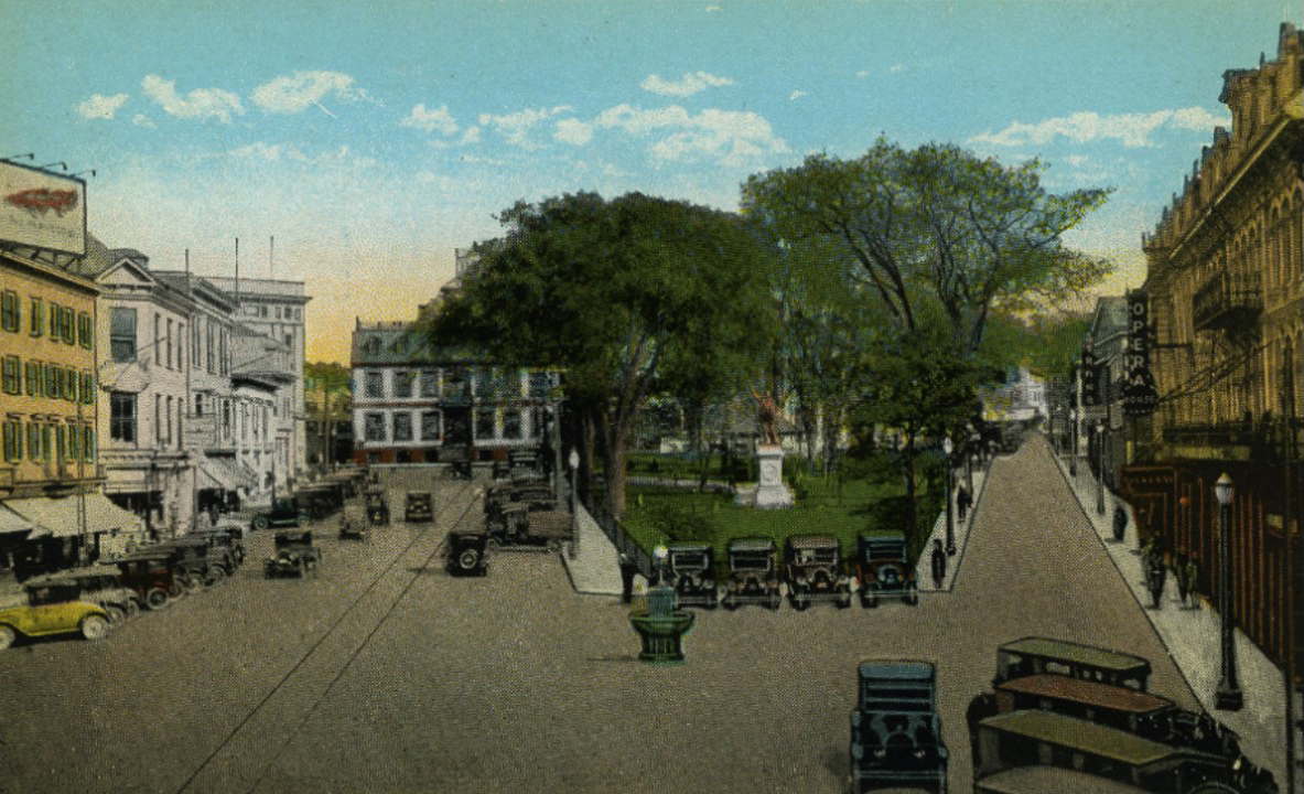 Washington Square looking east, early 1920's. The 4-story building on left will become the Savings Bank building in a few short years.
