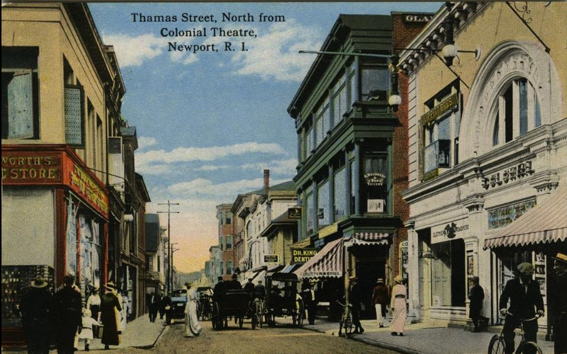 """Thames Street looking north in front of the Colonial Theater. Washington Square is 5 buildings up in this photo. The heart, like Washington Square, of the 9th city.  """"Finally there was, and is, and long will be the NINTH CITY, the American middle-class town, buying and selling, raising its children and burying its dead, with little attention to spare for the eight cities so close to it."""""""