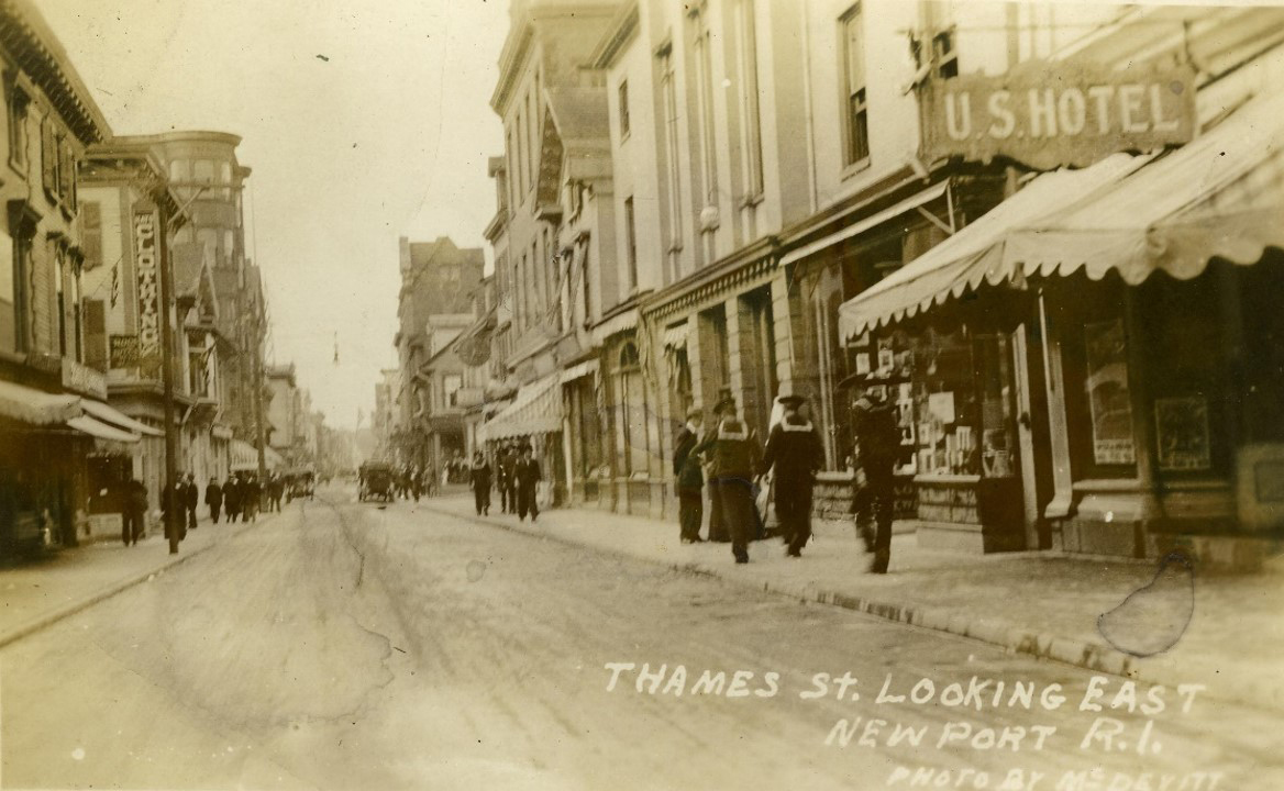 Thames Street looking north from Pelham Street. Although a little earlier (c. 190x), the city retained this view until the 1970's. Note the clock face on the right-hand side of the photo, 6 buildings up.