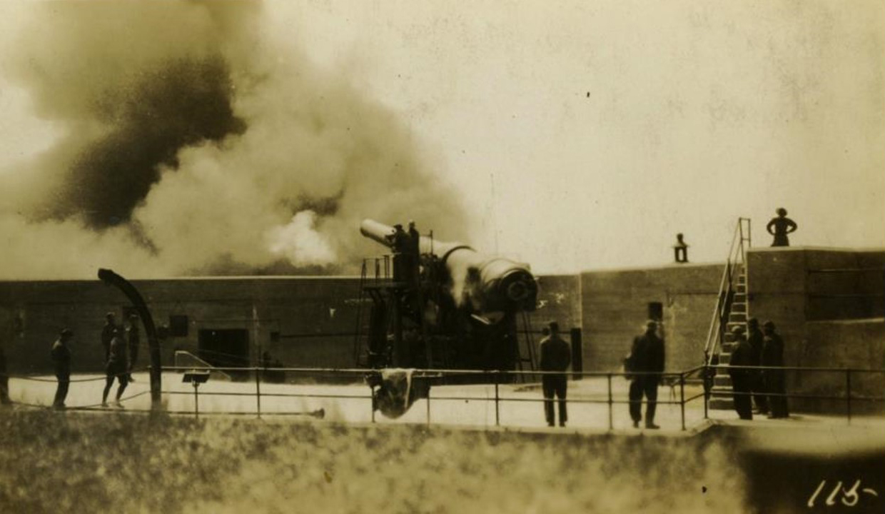 """This image show Battery Reilly, Fort Adams, a 10"""" Disappearing rifle being fired. Although Thornton did not service the batteries at Fort Adams, he would have been quite familiar with the area. This emplacement still exists, sans ordnance."""
