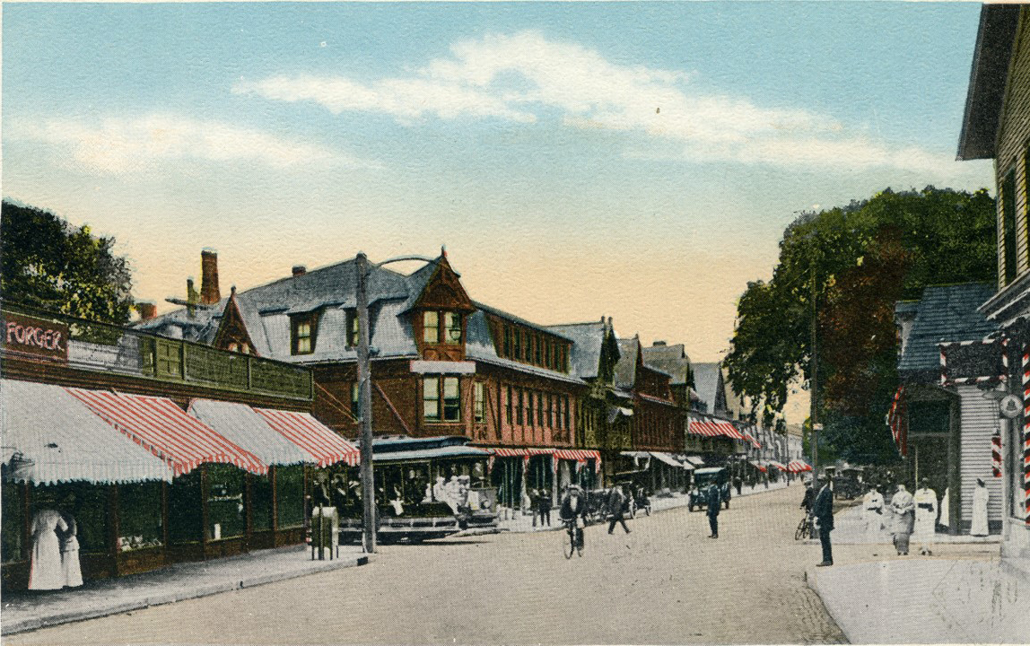Bellevue Avenue looking south from just north of Bath Road (now Memorial Boulevard). The left side of the street, just beyond the trolley coming from the beach still looks the same.