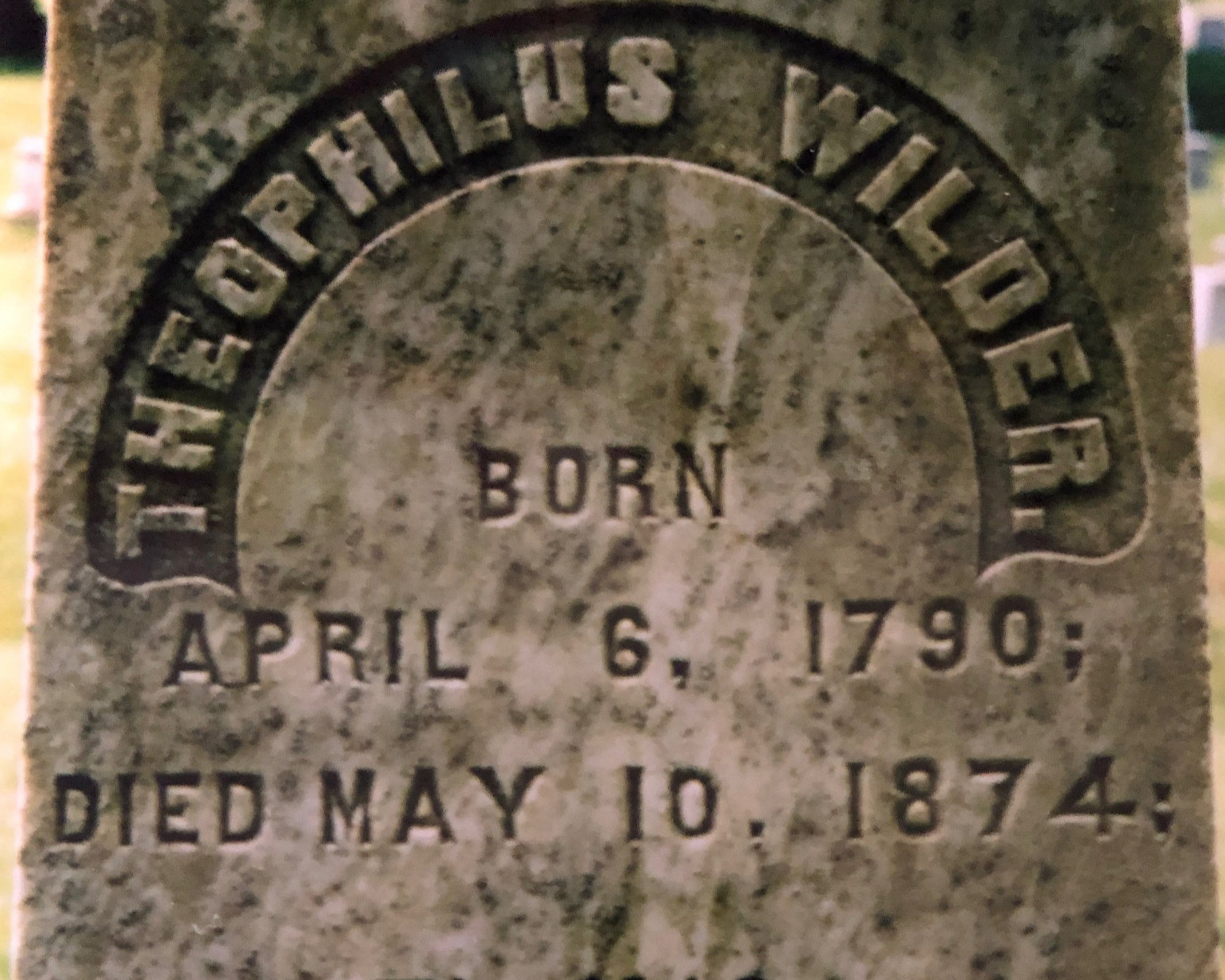 A closeup of Theophilus North, III's gravestone nearby.