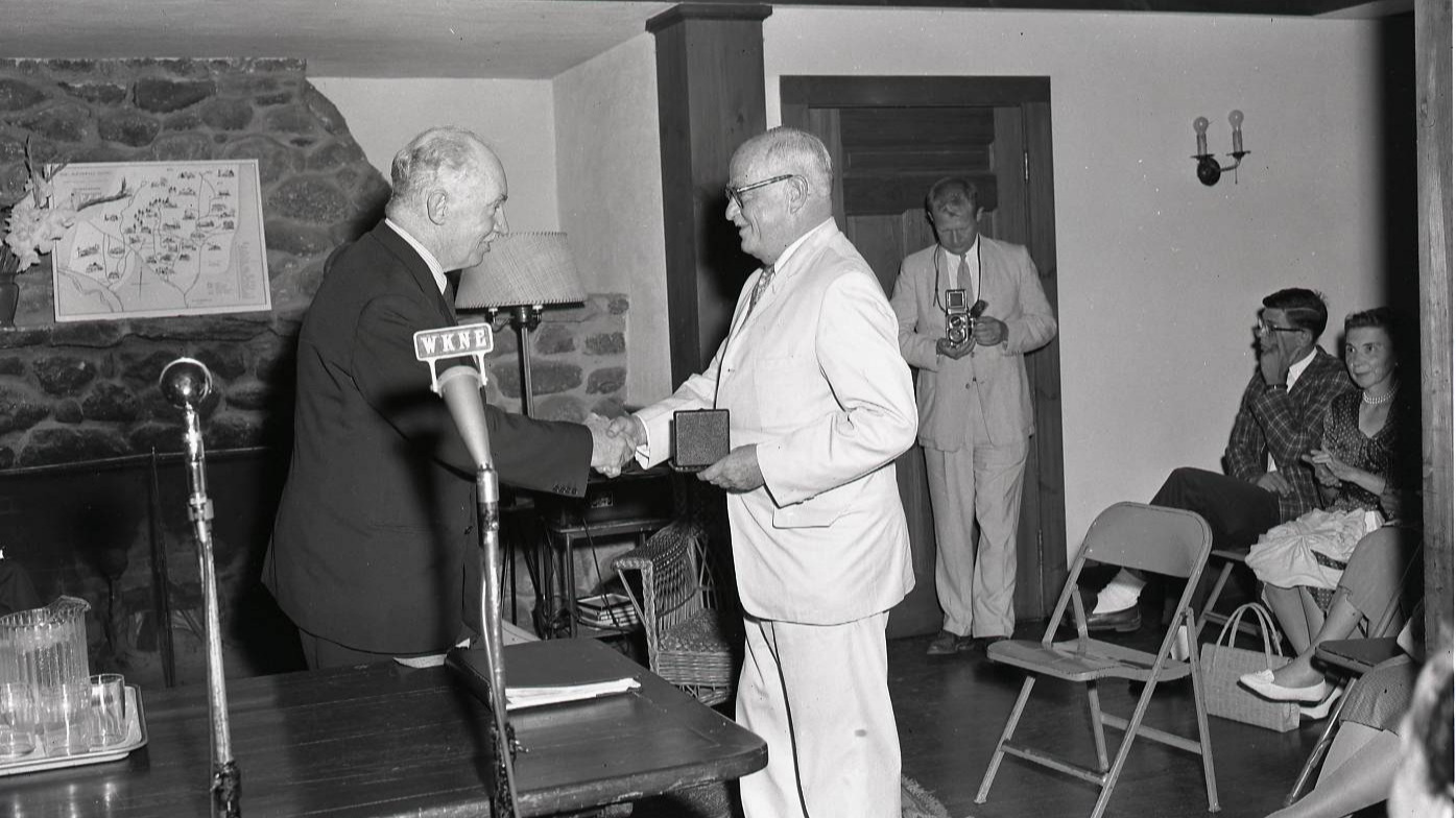Wilder accepting the first MacDowell Medal from James Johnson Sweeney, president of the Edward MacDowell Association on August 13, 1960. (Photo by Herbert Whitney)