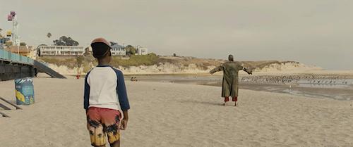 Jason seeing a stranger on the beach.