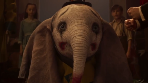 Dumbo being ridiculed in clown makeup.
