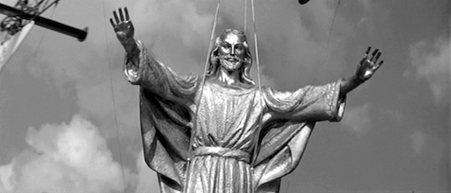 The statue of Jesus Christ being carried by helicopter at the beginning of the film.