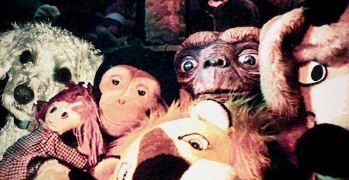 E.T. hiding amongst toys.
