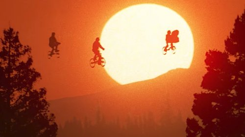 An iconic shot of E.T. lifting children on bicycles using psychic powers.