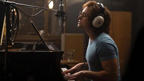 A younger, shyer Elton John getting studio time.