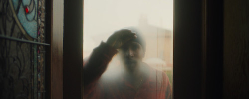 Fails peering into the house through a foggy window: a distorted depiction of home.