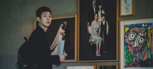 Son Ki-woo observing the ideal displays of a functioning, successful, happy family.