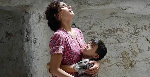 A young Salvador and his mother, both embracing their new living conditions.